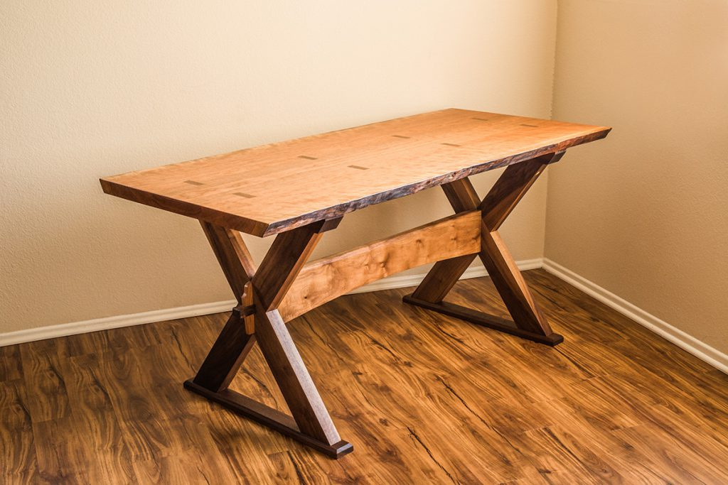Side view of the Cherry Live Edge Slab Sawbuck Table
