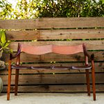 Brawley Made Hand Carved Maloof Settee Reproduction on a Back Patio